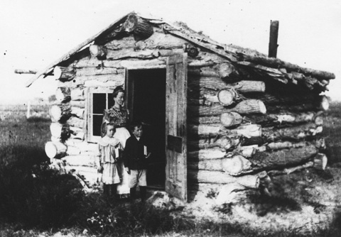 Annie Chamberlain Powers and her children Laura and John outside their sod-roofed house, built in 1905 near Lingle. Homesteader Museum.