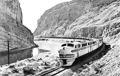 A CB&Q oil train passes north through Wind River Canyon during World War II.  It is led by a four-unit, 5400-HP set of FT diesel-electric locomotives.  CB&Q publicity photo, courtesy of Burlington Route Historical Society Archives.