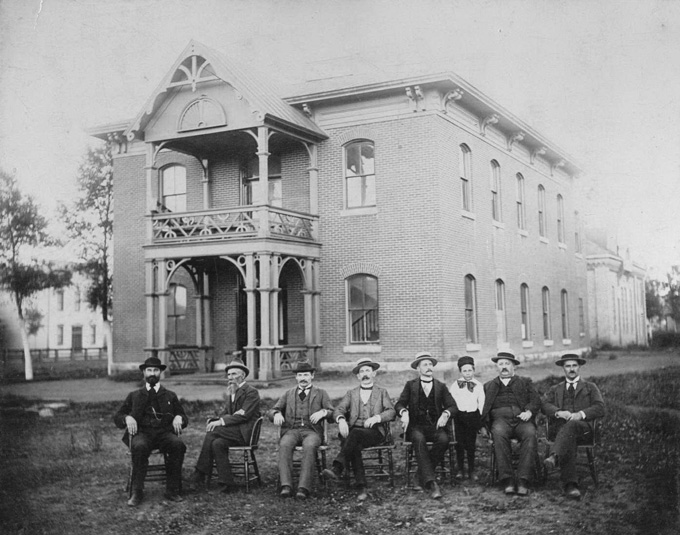 The Uinta County Courthouse about 1900, with some of its regular occupants. Wyoming State Archives.