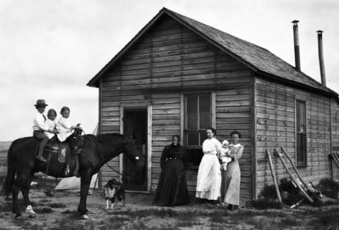 The Holmberg family in 1912, six years after Indian lands north of Wind River were opened to homesteaders. Riverton Museum.