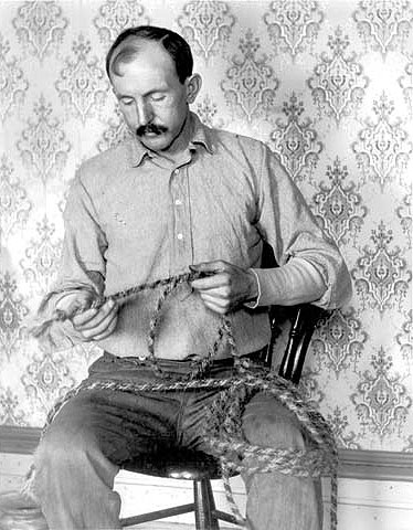 Tom Horn braiding rope in the office of the Cheyenne Jail, 1902. Wyoming State Archives.