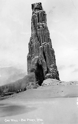 In the winter of 1938, a Wyoming Petroleum Corporation well near Big Piney, Wyo. blew out for two months and became coated in about 700 tons of ice before workers shut it in. Bill Williams collection, courtesy of Jonita Sommers.