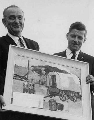 Campaigning together in Casper in 1964, President Lyndon Johnson and Wyoming's U.S. Senator Gale McGee admire a painting of a sheep wagon--a testament to the sheep industry's staying power in Wyoming politics.
