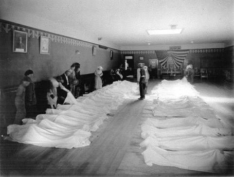 Townspeople identifying bodies after the 1923 coalmine disaster, Kemmerer, Wyo. American Heritage Center.