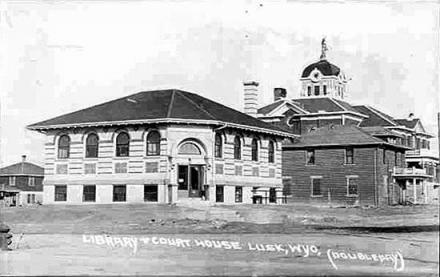 NIobrara County's courthouse, (rear) and Carnegie Library, about 1920. Wyoming Tales and Trails.