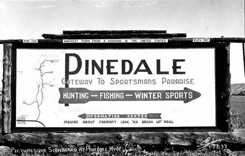 "This sign from the 1940s touts Pinedale as the ""farthest town from a railroad in the United States."" Wyoming Tales and Trails."