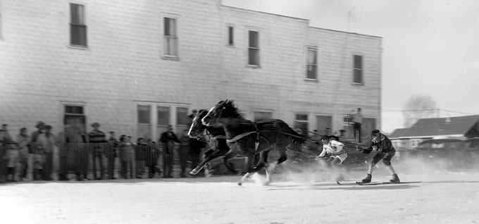 Ski-joring on Maybell Avenue in Pinedale, 1959. Paul Allen photo.