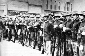 Federal troops, shown here on Front Street in 1885, stayed in Rock Springs for 13 years. Wyoming Tales and Trails photo.