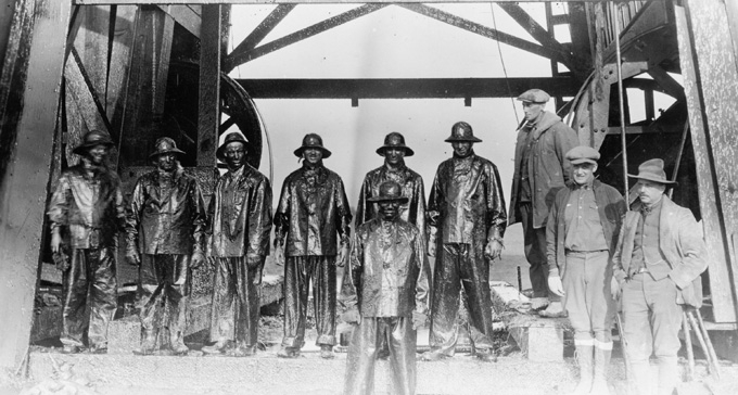 Roughnecks after capping an oil well in the Salt Creek field, 1920s. American Heritage Center, University of Wyoming.
