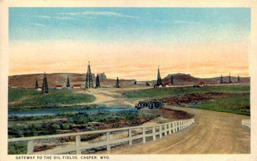 The Salt Creek oil field in the 1920s. Teapot Dome is the arched butte on the left. Wyoming Tales and Trails.