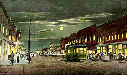 Sheridan at night, in a colorized daytime image with a false moonlit sky, featuring the Sheridan Railway Company streetcar.