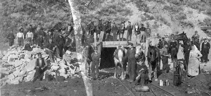 Coal miners and horses at the mouth of the Monarch Mine north of Sheridan, about 1903. Sheridan County Museum.