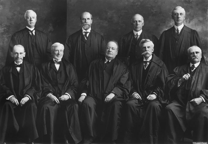 The Supreme Court at the time United States v. Midwest Oil was decided. Willis Van Devanter of Wyoming is second from the right in the back row. Collection of the Supreme Court of the United States.