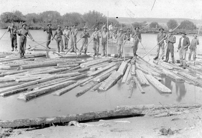 Tie-hacks, mostly from Sweden, Norway, Finland and Austria, were also called river rats and and were paid well for their dangerous  work. They are shown here with pike poles, moving ties down the Green River in the 1890s. Bill and Carrie Budd photo, Thelma Budd collection.