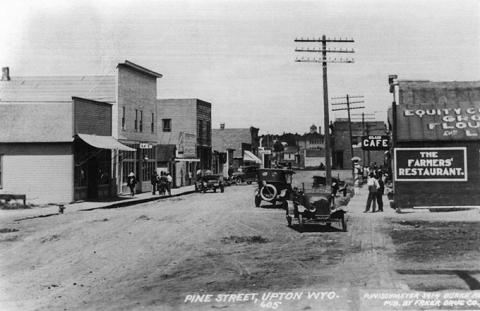 Pine Street served as Upton's main street around 1920, bustling with stores, businesses and a bank. Alice Schuette Collection, Weston County Historical Society.