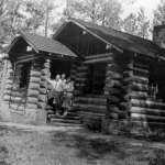 A 1931 log-on-stone custodian's residence was the first building at Devils Tower National Monument to be designed under official parkitecture standards. NPS.