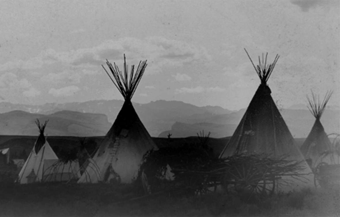 An undated photo of an Arapaho village on Little Wind River on the Shoshone Reservation. The mix of tents, tipis and wagons suggests the photo may be from the late 1800s. Wyoming State Archives.
