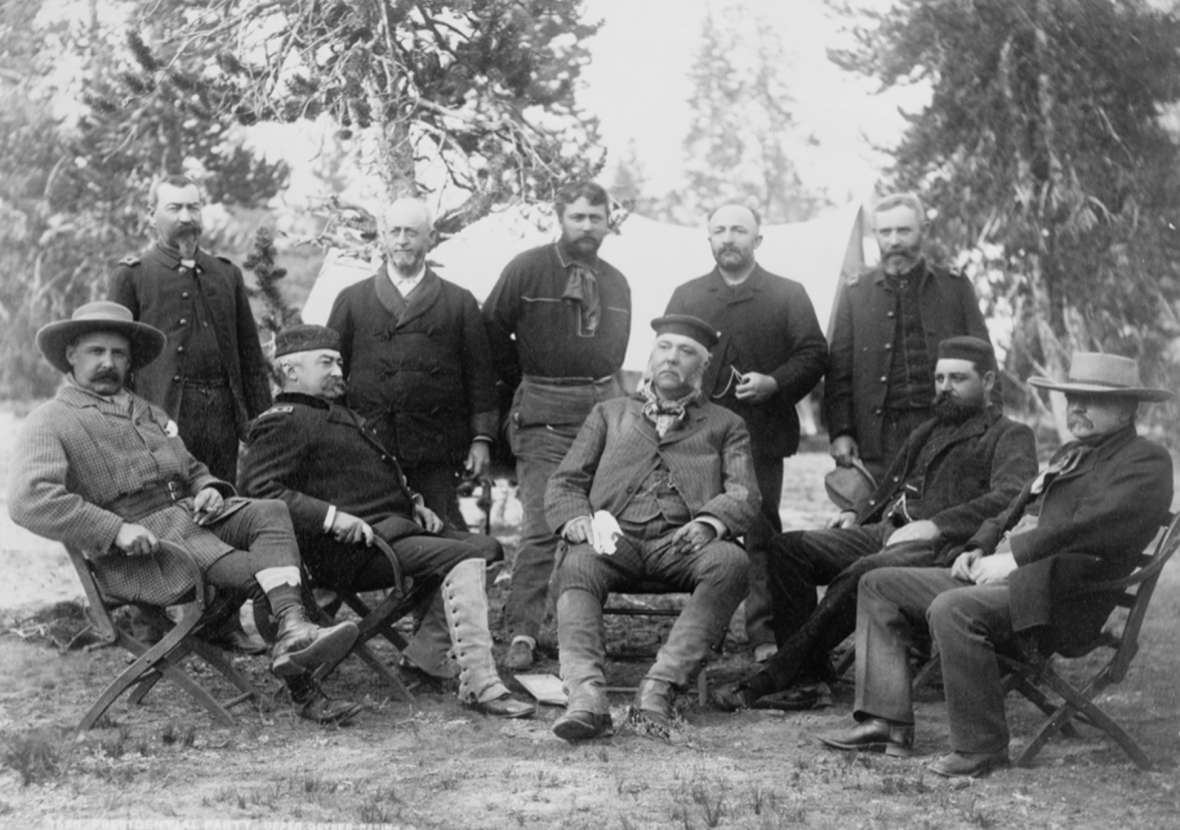 President Chester A. Arthur's party at Upper Geyser Basin in Yellowstone Park, August 24, 1883. Seated from left, Montana Gov. Schuyler Crosby, Lt. Gen. Philip Sheridan, President Arthur, War Secretary Robert T. Lincoln, Sen. George Vest; standing from left, Lt. Col. Michael Sheridan, Gen. Anson Stager, Capt. Philo Clark, Surrogate of New York Daniel Rollins, Lt. Col. James F. Gregory. F. Jay Haynes photo, Library of Congress.