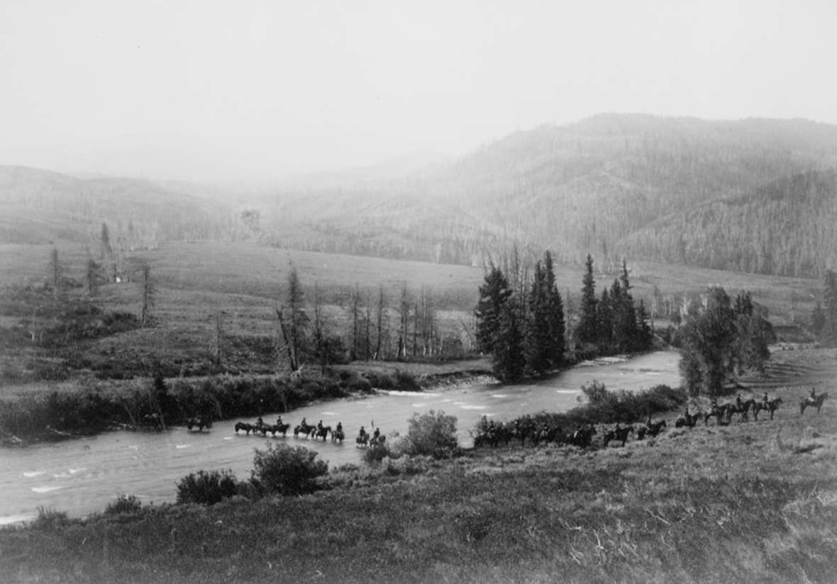 An escort of 75 soldiers and 175 pack animals accompanied the presidential party. From the headwaters of Wind River, they crossed the Continental Divide at Sheridan Pass, about 10 millers south of Togowotee Pass where the highway crosses today. From there they continued west down the Gros Ventre River to Jackson Hole. Here, the escort crosses the Gros Ventre. F. Jay Haynes photo, Library of Congress.