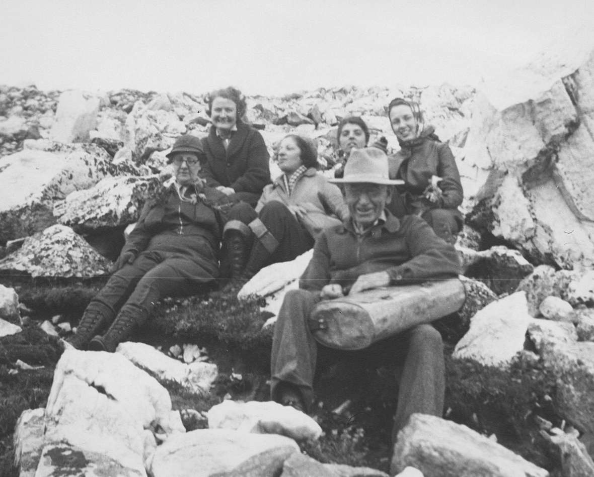 Aven Nelson and a few of his students, 1937. One student described him as 'part poet,' a 'great teacher' but an 'indifferent administrator.' Nelson is holding a vasculum, a container for carrying plant specimens from the field back to camp or the herbarium for pressing. American Heritage Center.