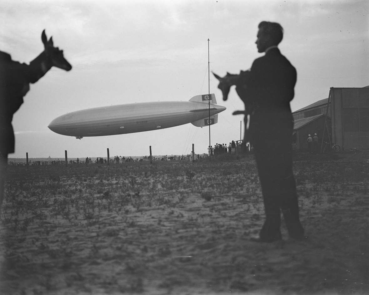 In 1936, two of Belden's captured pronghorn fawns were transported to Nazi Germany on the well-known blimp, the Hindenburg. But this is a composite—Belden manipulated the silhouettes into the photo in the darkroom. American Heritage Center.