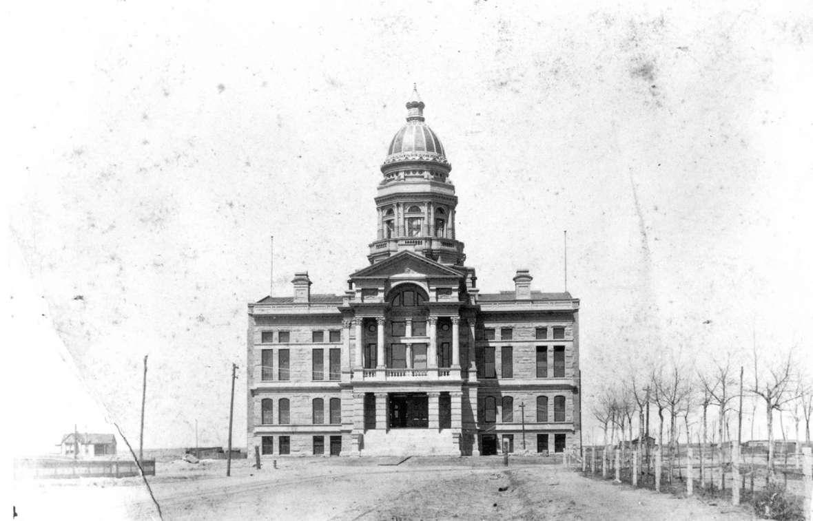 The initial phase of Wyoming's Capitol, designed by David Gibbs of Toledo, Ohio and built by Adam Feick and Bros. of Sandusky, included only what's now the center portion of the building. It was completed in 1888 while Wyoming was still a territory. Wyoming State Archives.