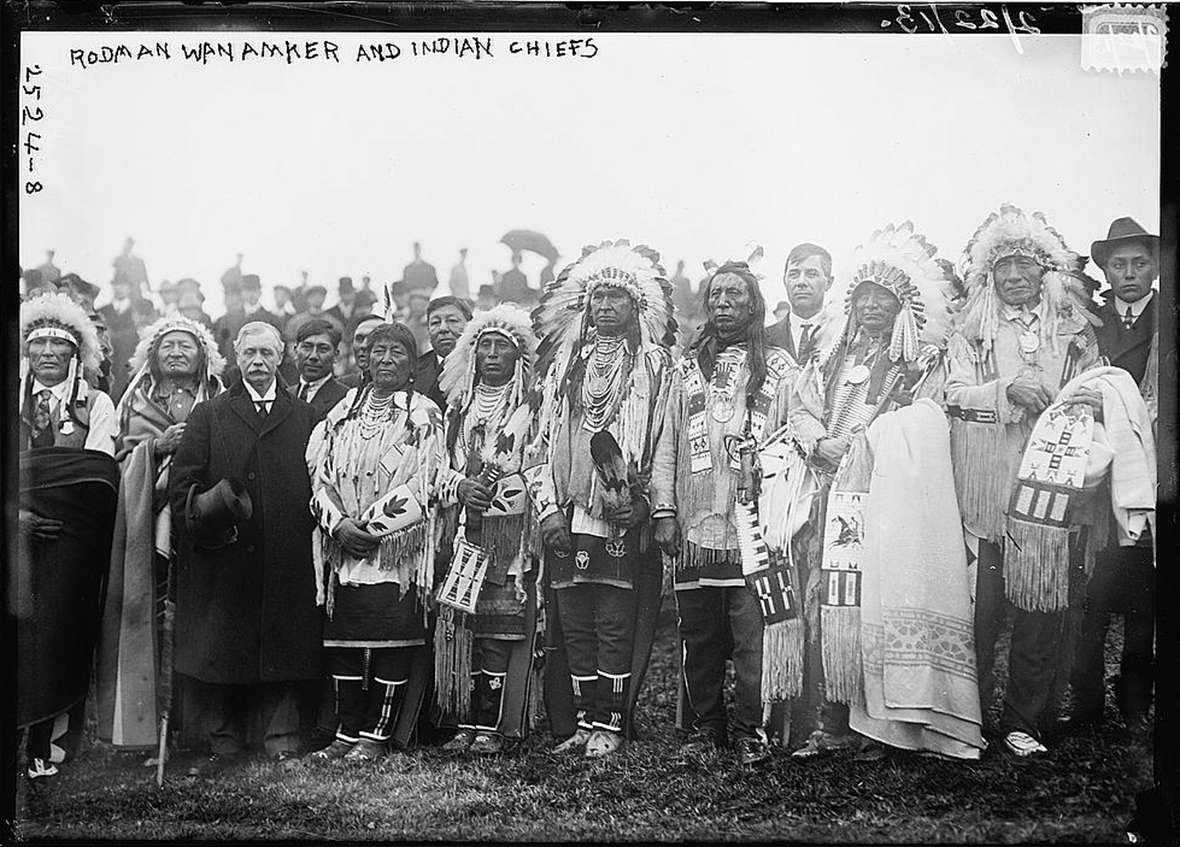 Around 30 American Indians from seven tribes joined Rodman Wanamaker, with top hat, at the groundbreaking for a planned National American Indian Memorial on Staten Island in New York City in 1913. Wikipedia.