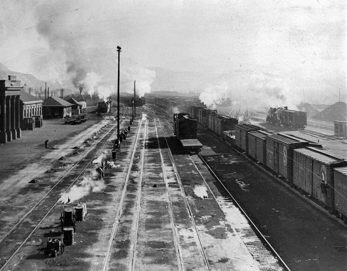 Coal-fired steam locomotives powered the Union Pacific Railroad for more than 80 years—and then, suddenly, they didn't. Shown here, freight cars and switch engines in the rail yard at Green River, Wyo., 1930s. Sweetwater County Historical Museum.