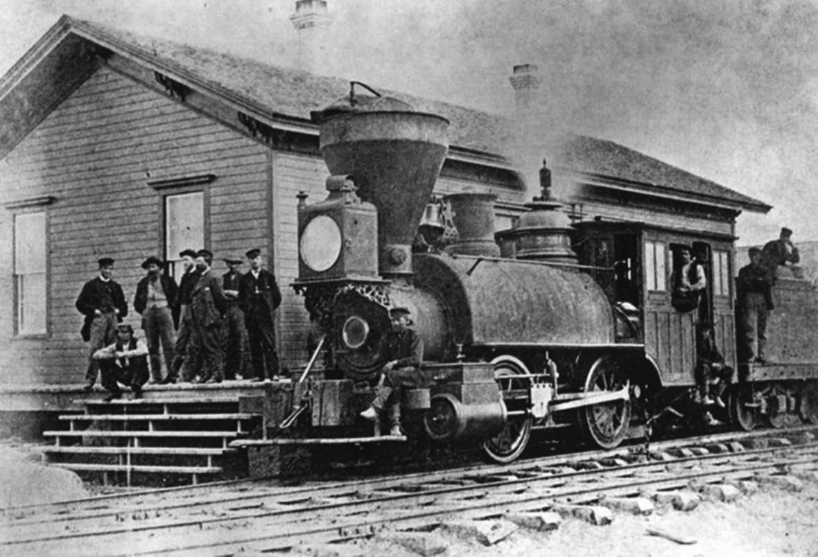 Anna Dickinson first stopped in Cheyenne in June 1869 when, traveling to San Francisco with a congressional committee, she stepped out on the depot platform for a breath of air. Shown here, the first locomotive to arrive in Cheyenne, 18 months earlier. Wyoming State Archives.