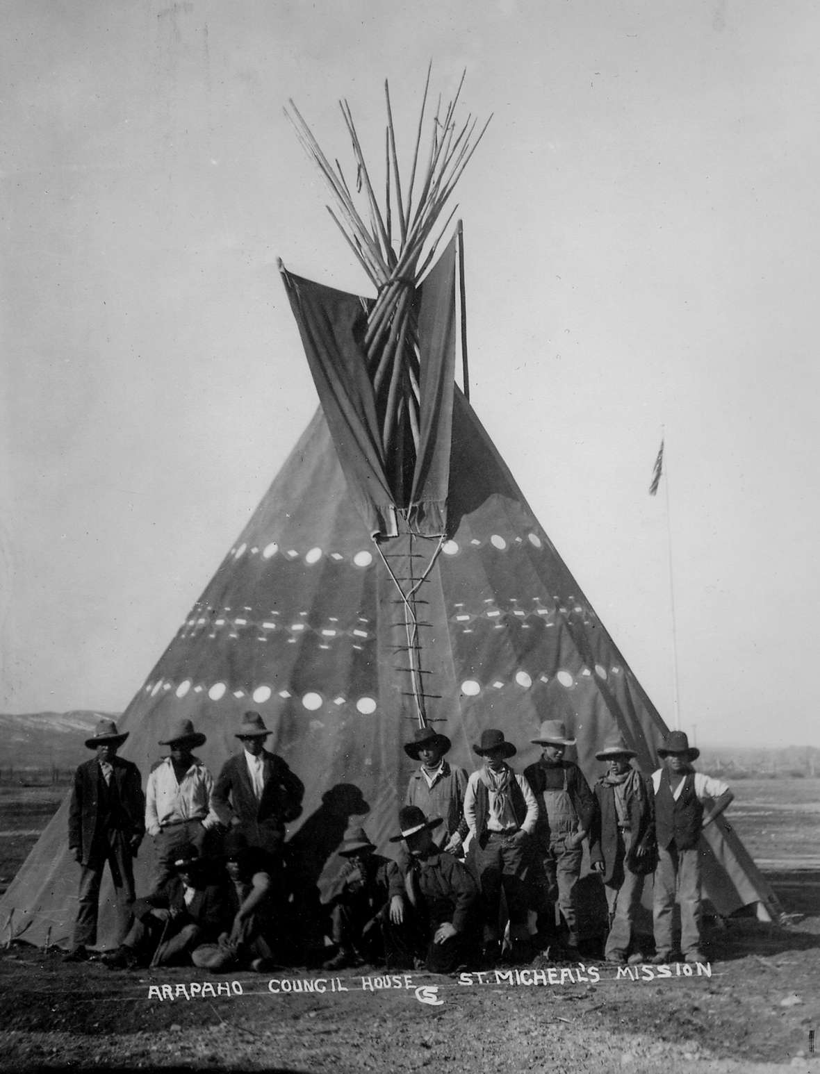 For a time in the 1920s a tipi painted with symbols served as a council house for the Arapaho Tribe at St. Michael's Mission at Ethete, Wyo. Charles Sproul photo, Riverton Museum.