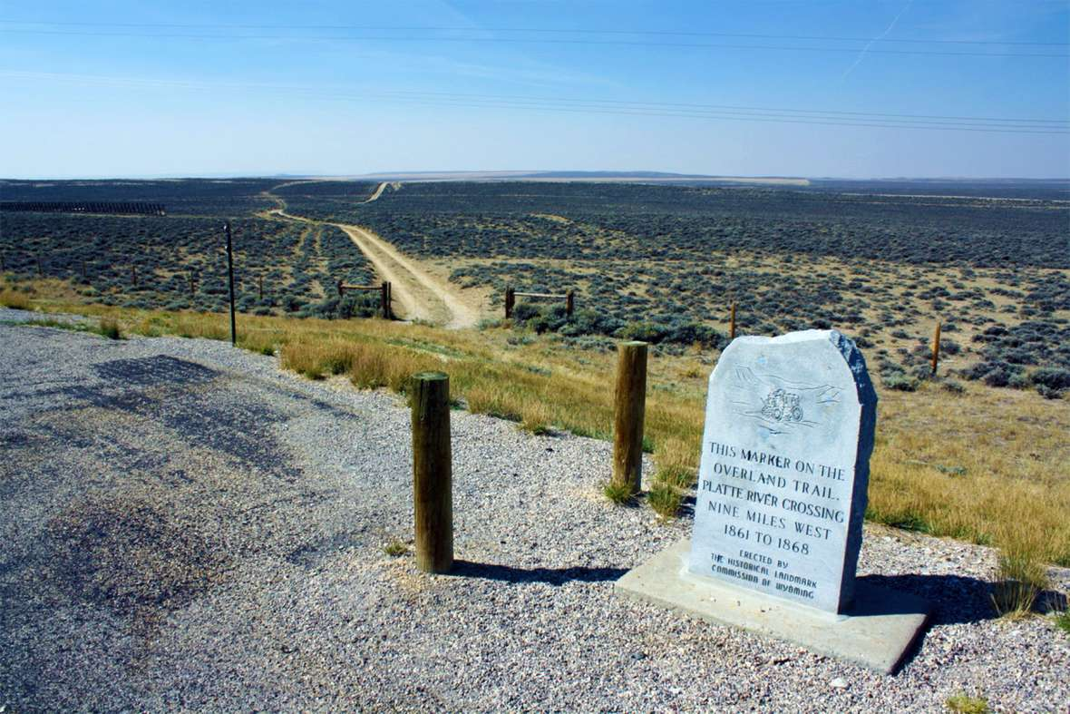 The Overland Trail still crosses wide stretches of treeless Wyoming. This marker is on the spot where the trail crosses Wyoming Highway 130 north of Saratoga, 25 miles southwest of Fort Halleck's location in the early 1860s and nine miles east of the North Platte River. Tom Rea.