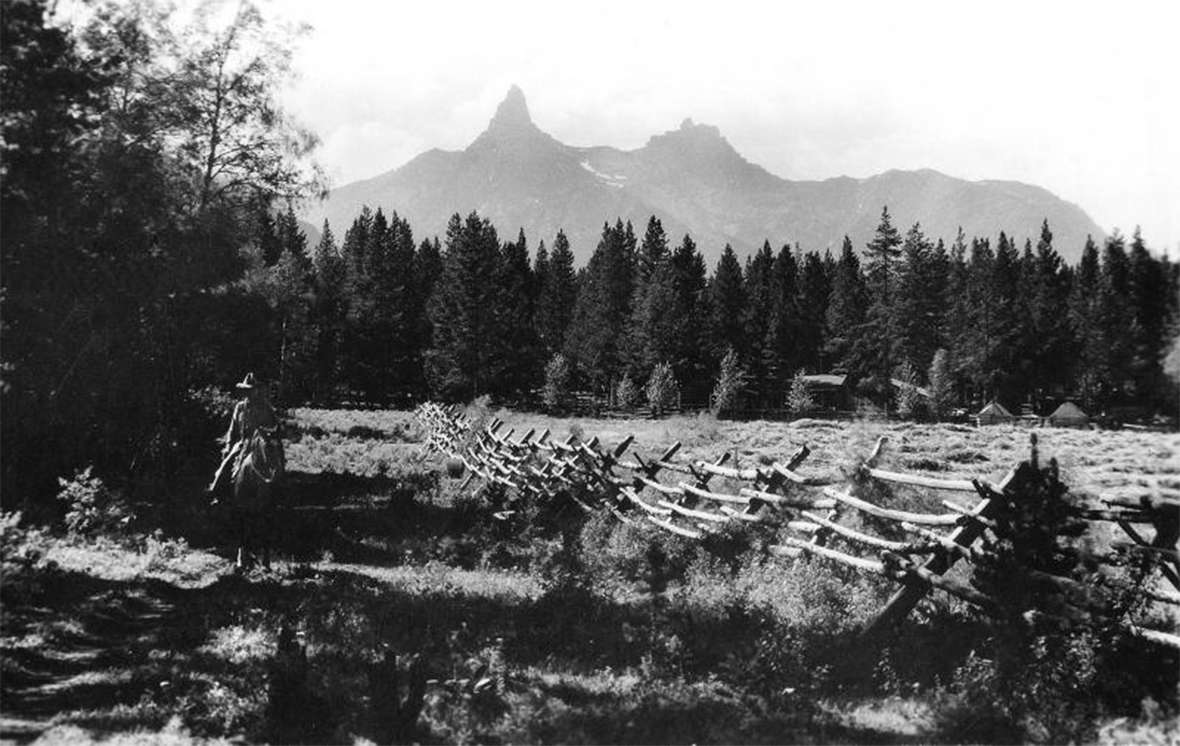 A 1930s view of Pilot Peak in the Absaroka Range northwest of Cody, from the L Bar T Ranch, where Hemingway, sometimes with his wife Pauline and their children, spent summers in the 1930s. Wyoming State Archives.