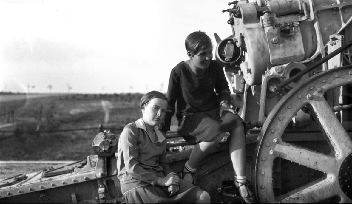 Two girls on a captured German howitzer in a park in Cheyenne, sometime after World War I. During World War II, state officials donated the guns to a scrap-metal drive, despite some local objections. Wyoming State Archives.