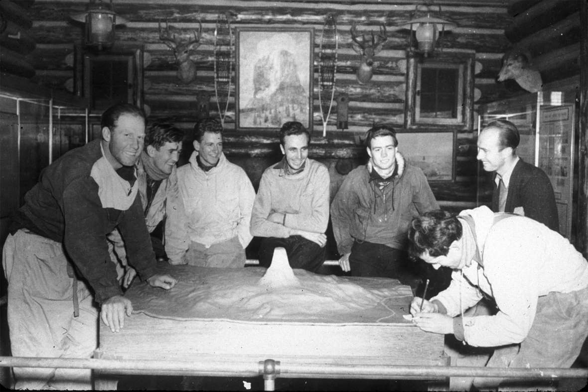 Jack Durrance (far right, leaning over the relief map) and his team plan Hopkins's rescue in the Devils Tower visitor center. NPS photo.