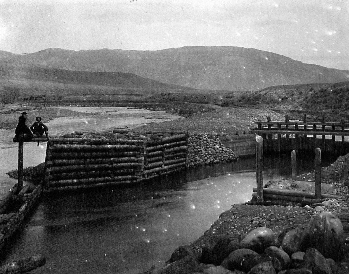 Headgate of a canal taking off from the South Fork of the Shoshone River upstream from Cody, Wyo., around 1896. The Shoshone Land and Irrigation Company, owned by George Beck and William F. Cody, began digging the canal the year before. American Heritage Center.