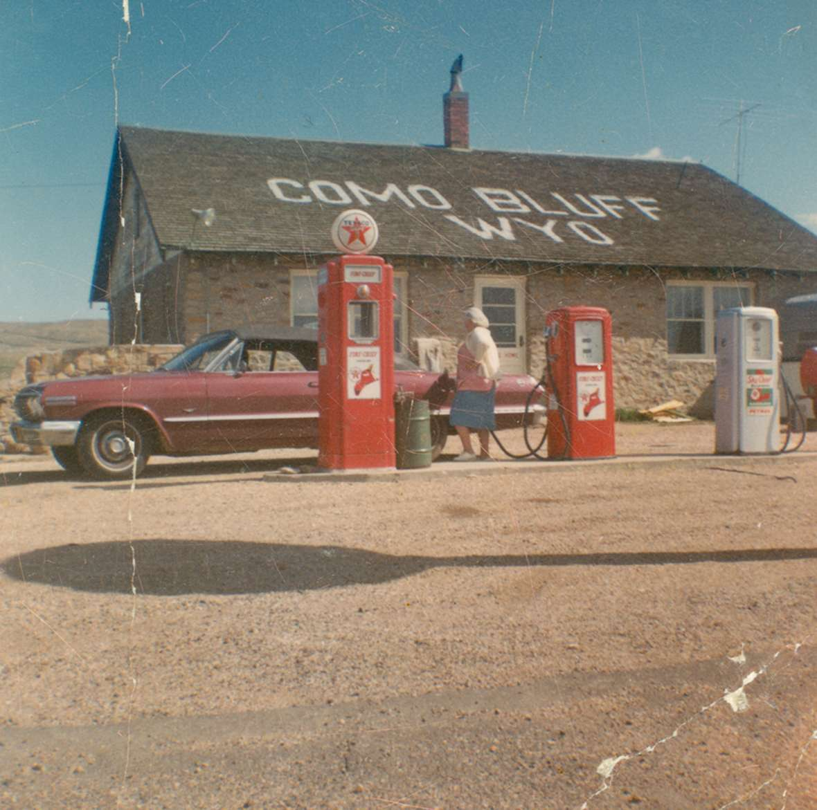 At Como Bluff east of Medicine Bow, the Boylan family in the 1930s built the famed 'fossil cabin' out of pieces of dinosaur bone and other fossils, together with this more conventional house. The roadside attraction and Texaco station continued operating into the 1970s—but after 1970, when Interstate 80 was completed, business would have contracted severely. Wyoming State Archives.