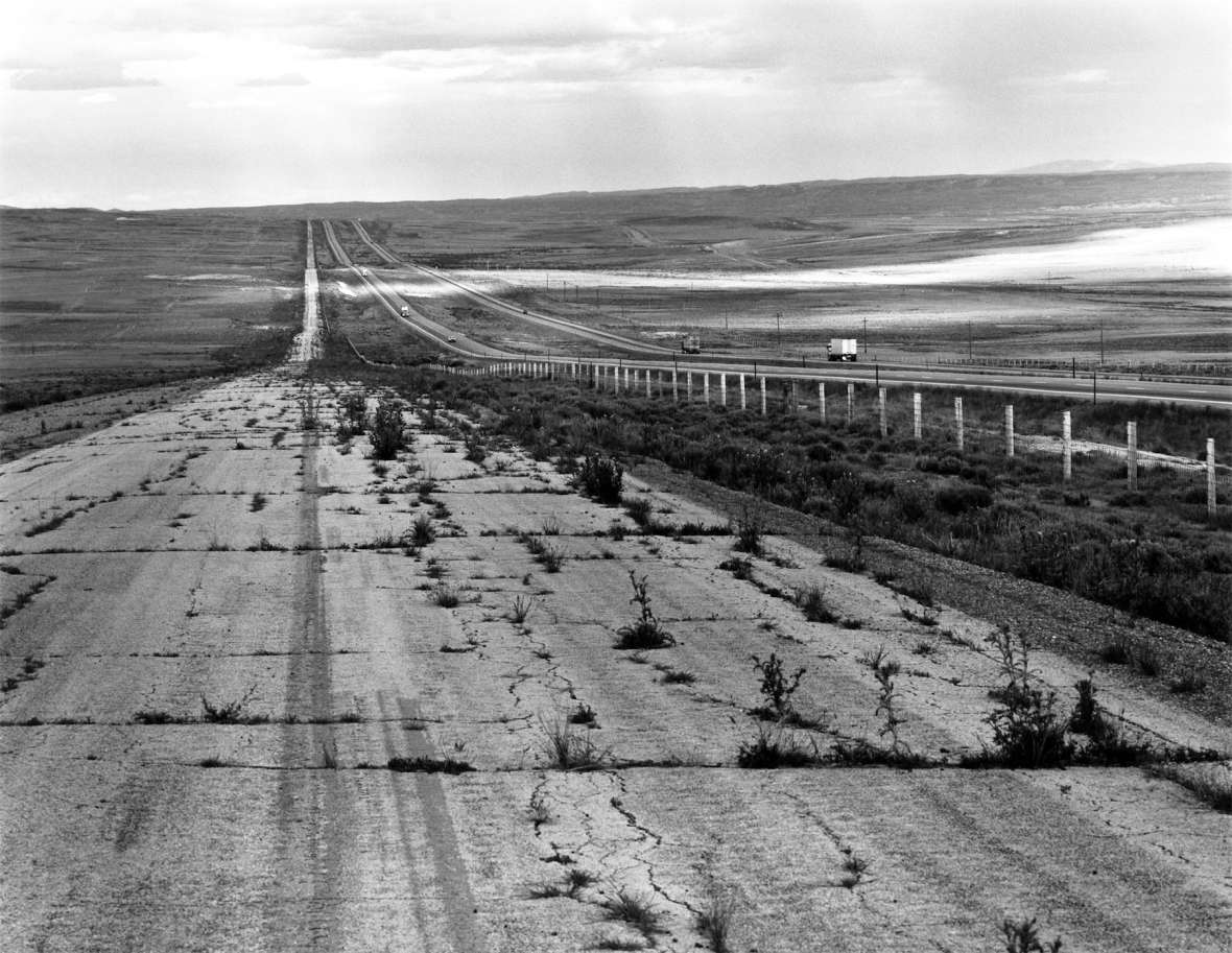 By the 1980s, when this photo was taken, grass was starting to grow through the cracks of the former U.S. 30, shown here in a stretch paralleling Interstate 80 near Creston, Wyo., and the Continental Divide. Drake Hokanson photo.