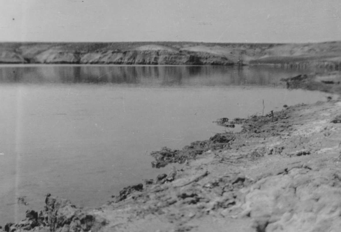 The larger of two irrigation reservoirs on the Love ranch, 1913. A few months after the dam was finished, a hailstorm so strained it that it broke. The flood ruined most of the crops. Love family photo.