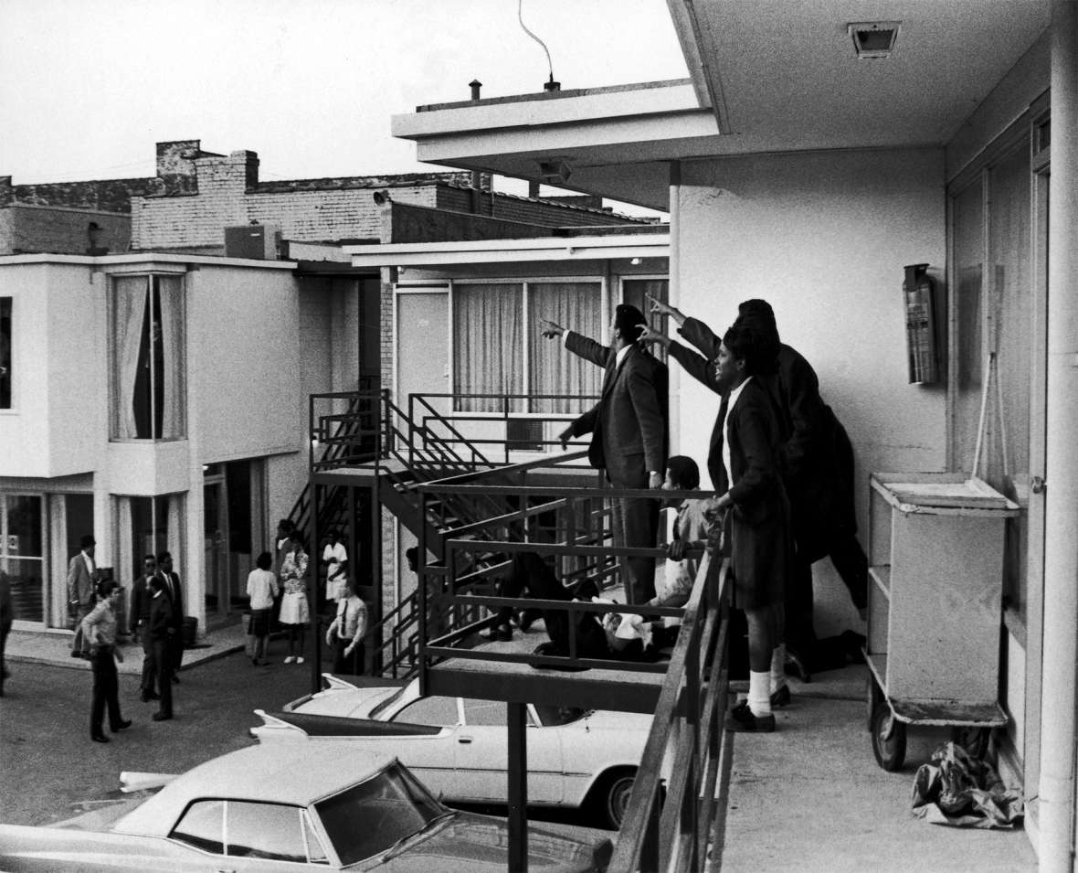 From the balcony of the Loraine Motel in Memphis, the Rev. Martin Luther King's closest advisors point to the window where the deadly shot came from, April 4, 1968. The motel is now part of the National Civil Rights Museum. Getty Images.