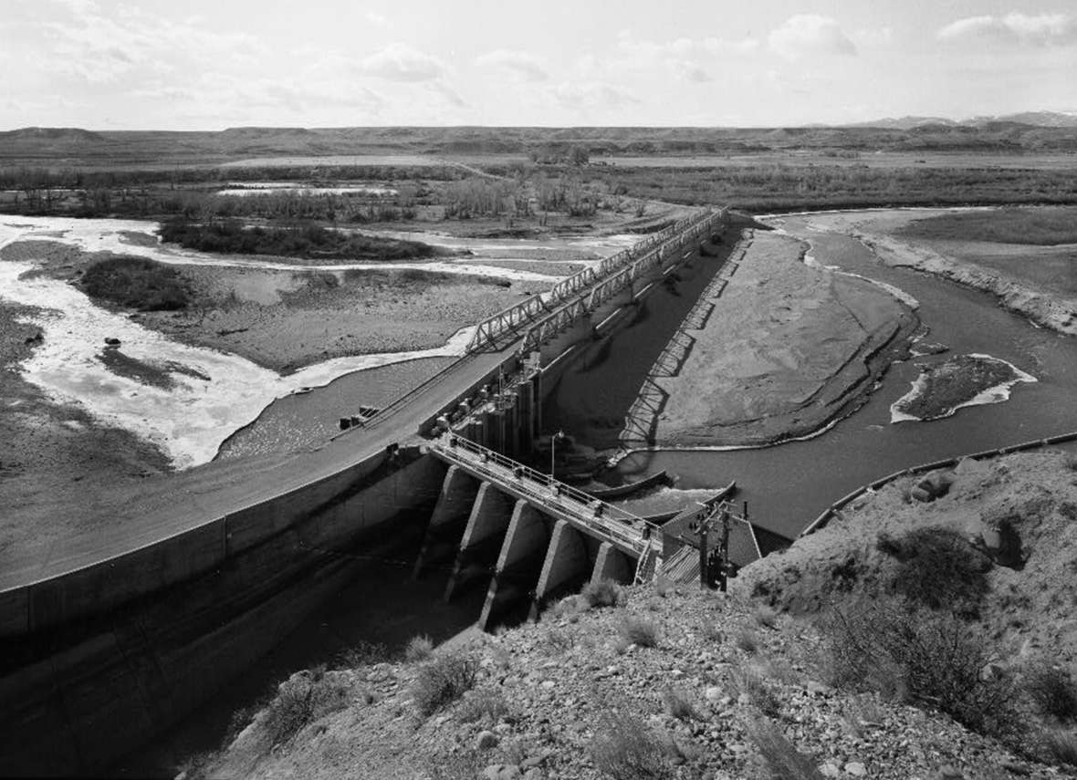 Built in 1923 to take water from the main stem of the Wind River for irrigators to the north, Diversion Dam was key to the U.S. Reclamation Bureau's new Riverton Project, later called the Midvale Irrigation District. Library of Congress.