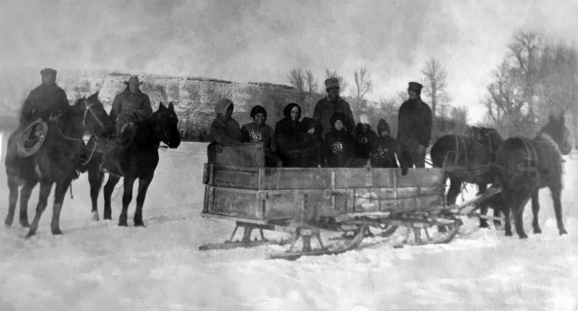 Stepp family members heading to the Green River, above, and below, cutting ice for the ice house, around 1920. Stepp family photos.