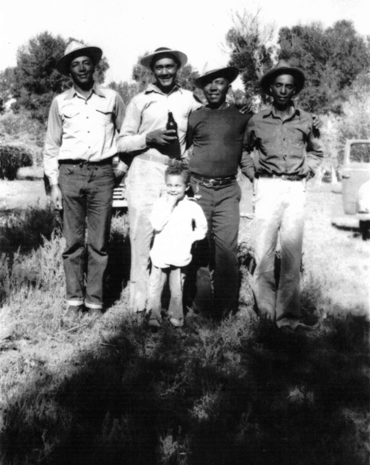 "Left to right, Bill Stepp, brother-in-law Ed Steward, John and Horace Greeley ""Dutch"" Stepp; Dutch's son Gary in front. Bill, John and Dutch were sons of Lon Stepp. Around 1950. Stepp family photo."