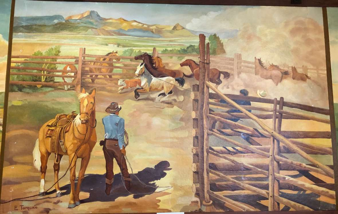 One of several western-themed murals by Italian POW Enzo Tarquinio painted in 1943-44 at the Camp Douglas officers' club, Douglas, Wyo. Tarquinio and two other prisoner-artists used pictures by William Henry Jackson and Charlie Russell as starting points, but added some very Italian touches. Laura E. Ruberto photo. Click to enlarge.