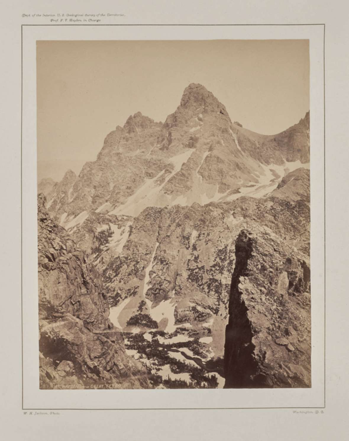 The Grand Teton from the top of Table Mountain on the Idaho side, by Hayden Expedition photographer William H. Jackson, August 1872. Note the absence of snow above the Lower Saddle at the right. Getty Museum.