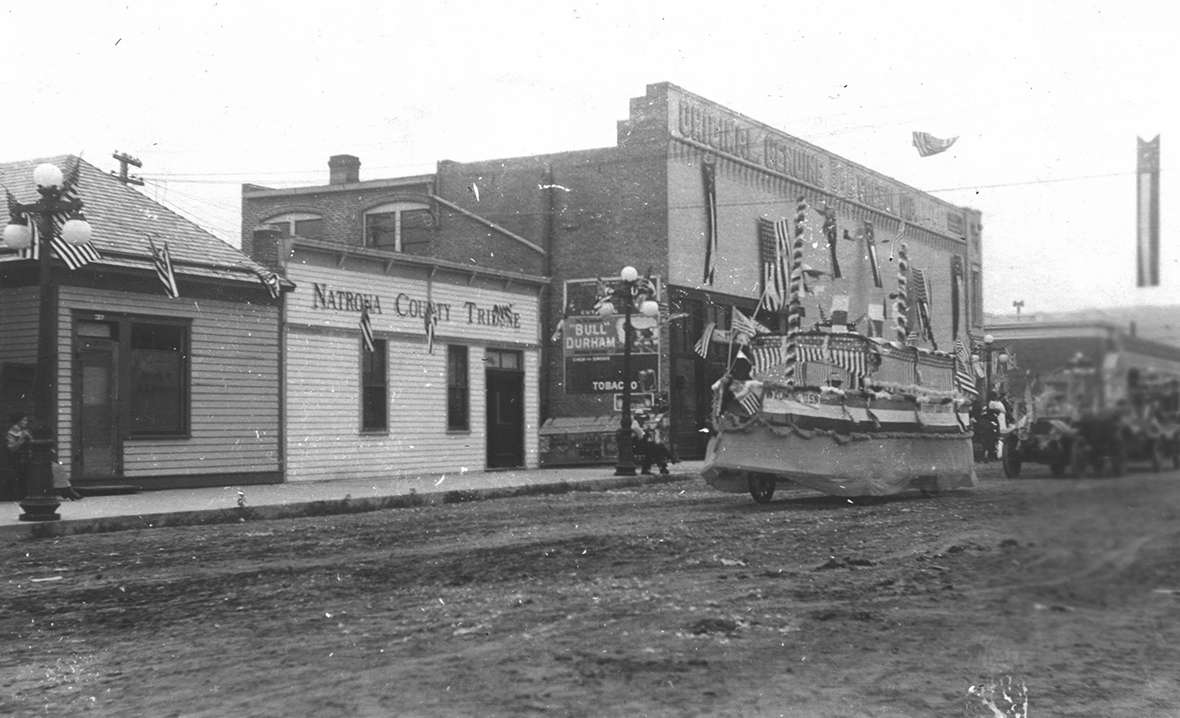 A parade through downtown Casper, Wyo., about 1910, with a float modeled on the battleship 'Wyoming.' Fort Caspar Museum collections.