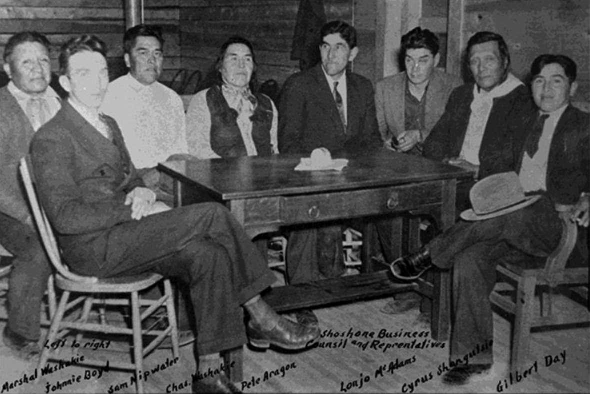 Shoshone Business Council members about 1940. Left to right, Marshall Washakie, Johnnie Boyd, Sam Nipwater, Charles Washakie, Pete Aragon, Lanjo McAdams, Cyrus Shogutsie, Gilbert Day. American Heritage Center.