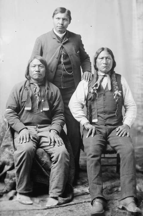 Sherman Coolidge stands with the longtime Arapaho leader Black Coal, right, and Painting Horse. During his time on Wind River, Coolidge consistently allied himself with U.S. government agents in their attempts to impose Washington's will on the Arapaho and Shoshone people. American Heritage Center.