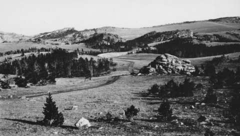 The rolling limestone plateau, much of it above 9,000 feet, 30 miles east of Lovell, Wyo., and 12 miles south of the Montana border is an important prehistoric archeological landscape as well as an ancient Native American spiritual site—where tribal ceremonial activity continues to this day. This photo was taken in 1934; the country looks much the same now. American Heritage Center.
