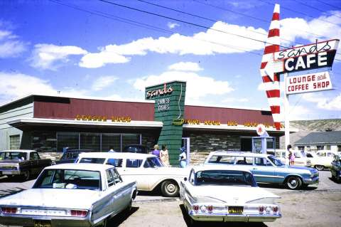 After retiring from the railroad, Finis went into the scenic and commercial postcard business using his own photographs. This one shows the Sands Cafe in Rock Springs in 1965. American Heritage Center.