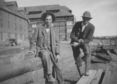 Architect Robert Reamer, left, with his foreman at the Canyon Hotel in Yellowstone in 1910, is most famous for designing the Old Faithful Inn, a remarkable building that blends effectively with its surroundings. NPS photo.
